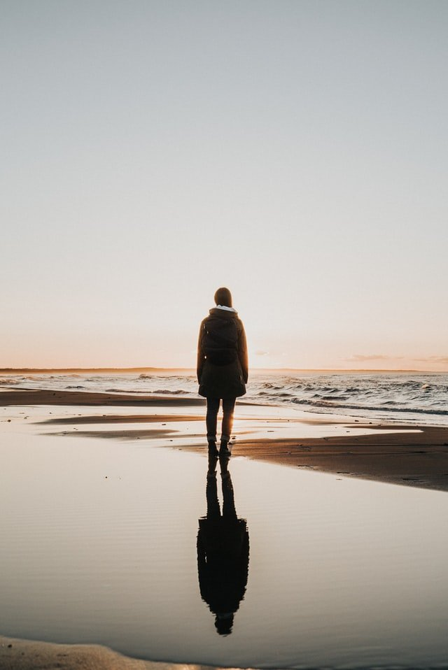 Young woman on a beach at sunset