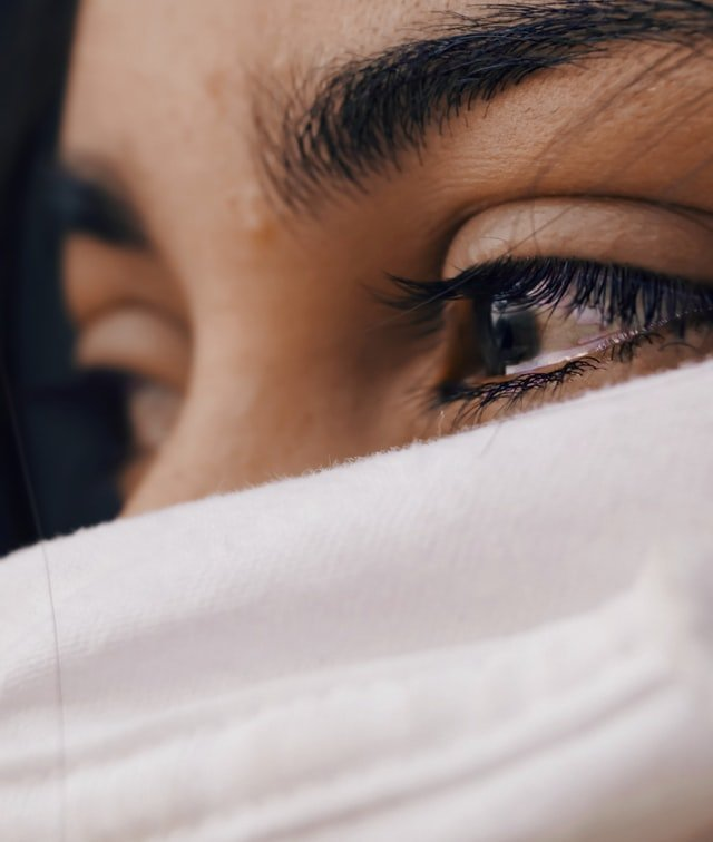 Girl with dark eyes tearing up
